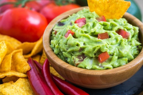 Want a simple and easy homemade guacamole recipe with or without cilantro that's healthy while still tasting fabulous? Give my 5-ingredient guacamole a try! It may not be a truly authentic Mexican recipe, but it's a close second. Seriously.