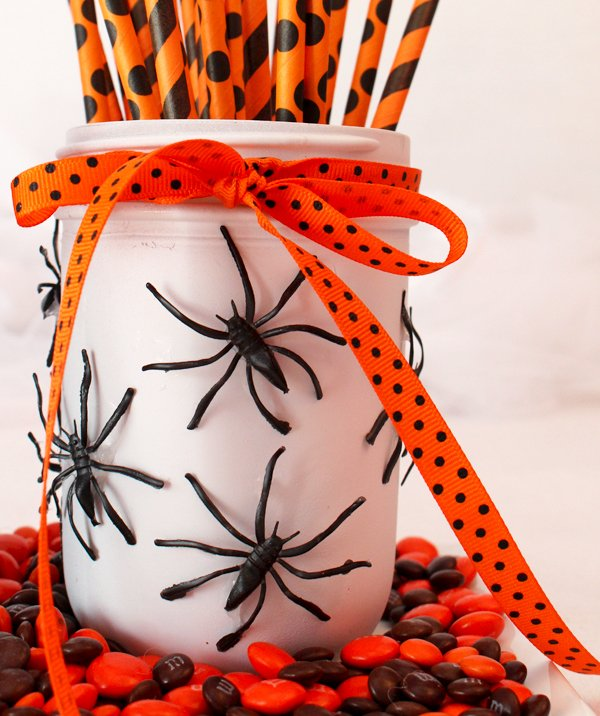 If you're looking for the perfect (and easy!) DIY Halloween decorations to make your home look spooktacular while still maintaining a classy sense of style, these mason jar Halloween decorations are for you. They offer a cheap and elegant way to dress up an outdoor trick-or-treating station, and they make a fabulous center piece for Halloween parties and get togethers.  Don't forget to get your kids involved - this is the perfect Halloween craft for little hands!