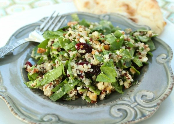 Quinoa is a gluten-free nutritional powerhouse that is loaded with fiber and protein to help you feel full longer (hello, weightloss!).. There are so many healthy and easy quinoa recipes you can enjoy - Thai, Mediterranean, Asian, Greek, and Mexican to name a few - and we LOVE this simple and easy Spinach and Quinoa Salad with Toasted Cashews and Dried Cranberries. It makes a fabulous post-workout meal, and offers a great side to enjoy with friends and family!