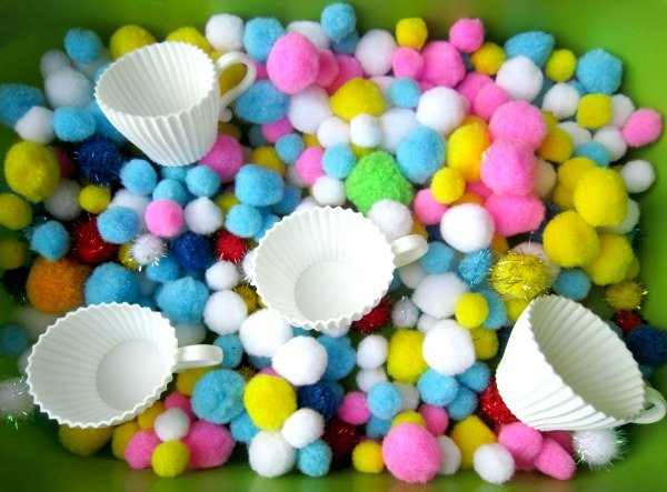 Sensory play allows children to learn through hands-on activities that stimulate their senses, and this Tea Cup Sensory Bin is one of many fabulous mothers day activities for kids! By using using pom poms and various fine motor tools, you and your little will enjoy hours of fun with this mess-free tea party fine motor activity!