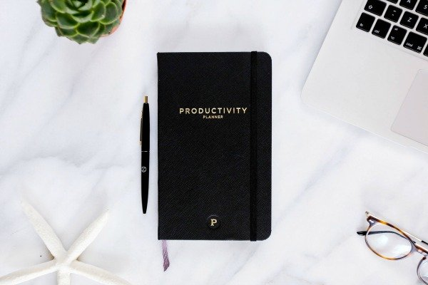 What to know how to be a productive person? It's not as hard as you think. We're sharing ONE tip we use on the daily to stay focused, reach our goals, and get more done in less time, even on days when life is hectic, busy, and chaotic. This productivity tip will give you the tools you need to learn how to make a morning routine that works so you can wake up with focus and direction each morning. Having a work-life balance has never been easier!