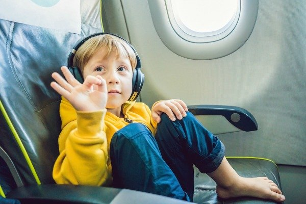 Traveling with an Autistic Child | Whether you're flying with an autistic child, or embarking on a long car ride with an autistic child, we have 7 helpful travel tips to make the experience as easy as possible. From picking a destination and using visual schedules to knowing what to pack and the best travel toys for kids, we've got everything you need for a smooth vacation!
