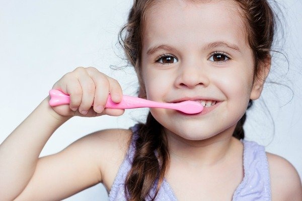 Toddler won't brush their teeth?! We've got 7 mom hacks and teeth activities to help encourage proper dental hygiene without whining! These tooth-brushing tips for toddlers will help you improve your child's oral health while still maintaining your sanity. My daughter didn't tolerate a toothbrush until she was 3, but thanks to these tips and tricks, she LOVES brushing her teeth. Just don't try tip 5. Seriously!