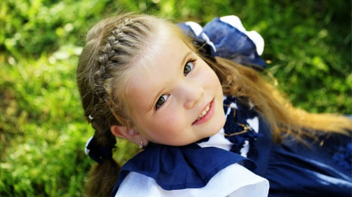 15 Easy Braid Hairstyles for Kids | These simple hairstyles for kids are a cute way to dress-up your daughter's hair for back to school, at weddings, for dance class, and beyond! With 15 step by step tutorials, we'll teach you how to French braid hair and teach you how to do Dutch braids, crown braids, waterfall braids, and so much more! #braids #braidsforkids #hairstylesforkids #frenchbraid #dutchbraid #schoolhairstyles #waterfallbraid