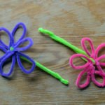 26 Dollar Store Crafts for Kids | Buttons, popsicle sticks, pony beads, drinking straws, and pool noodles, oh my! If you're looking for EASY crafts to do with your kids at home, these dollar store activities are for you! Whether you're the parent of busy toddlers with short attention spans, or older children who can sit still longer, these fun projects will inspire you. Perfect for cold winter weekends, hot summer vacations, and everything in between! #dollarstorecrafts #kidscrafts #easycrafts