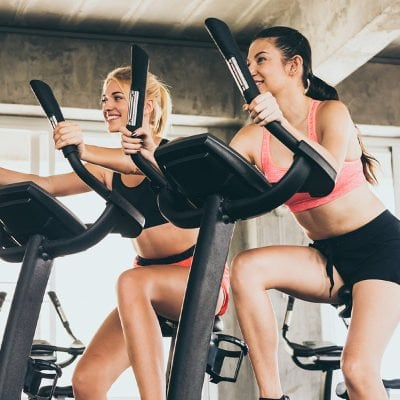 Indoor cycling 101: 4 stationary bike workouts for weight loss