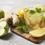 20 Ginger Water Recipes We Love | Ginger is a well known natural remedy for nausea, but did you know it can help burn fat and help with weight loss? If you want to know how to make ginger water – and all the health benefits it offers – this post has it all, including 20 recipes to help you detox, burn fat, lose weight, and get that flat belly you've always wanted! #ginger #gingerwater #ginerwaterrecipes #flattummy