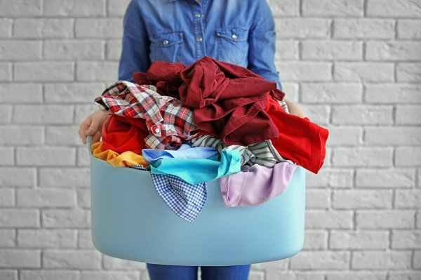 15 Laundry Hacks for Busy Moms | If you're looking for tips and tricks to help you stay on top of the never-ending pile of clothes that need to be washed, folded, and put away each week, this post is for you! Kids create a surprising amount of laundry with a ton of (questionable) stains, and we're excited to teach you how to remove stains, our best DIY stain removers, how to get whiter whites, and other simple ways to streamline your weekly laundry routine. #laundryhacks #momlife #cleaninghacks