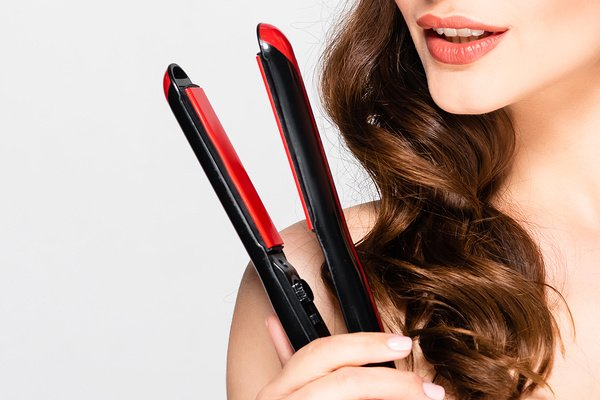 How to Curl Your Hair with a Flat Iron | Whether you have short, medium length, or long hair, learning how to curl hair with a flat iron is a game changer! We're sharing our best tips, hair hacks, and products to teach you how to get perfect beach waves, tight curls, and everything in between. We've also included 3 step by step tutorials for beginners with quick, easy, and simple techniques for curls that last! #howtocurlhair #curlinghairflatiron #flatironcurls