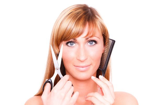 How to Trim Your Own Hair | If you're looking for step-by-step instructions to help you learn how to cut hair at home, this post has 14 tips and tutorials to help! Whether you're trying to get rid of split ends at home, cut a pixie cut, bob, or lob, trim long hair with layers, or cut your own bangs, we've curated the best hair cutting tools, products, and techniques to help. Learn how to keep your hair even, how to cut the back of your own hair, and how to cut curly hair like a pro!