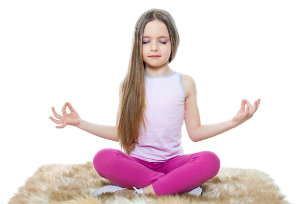 Yoga for Kids | Whether you're looking for yoga poses you can do in the classroom, or kids yoga videos you can stream from home, we're sharing 12 kids yoga poses and videos designed to help little ones stretch and strengthen their bodies, while also allowing them to calm down, relax, focus, and concentrate. You can do these in the garden or at the beach in the summer, as part of your morning and/or bedtime routine to promote sleep, and they make great brain breaks for virtual learning too!