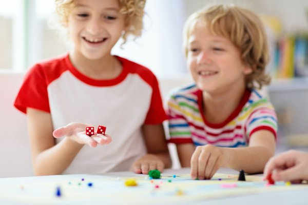 10 Easy Dice Games for Kids | If you're looking for portable travel games and/or need ideas for family game night, these dice games are family friendly and much fun. With options for 2 players as well as games you can play with a large group, we've included a mix of simple DIY dice games and classic store bought games you'll love. These make great camping activities, and are also perfect for road trips and those who need airplane activities for kids. Roll the dice and see what you think!