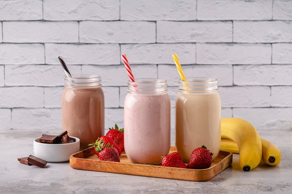 21 Healthy Milkshake Recipes for Weight Loss | If you're on the hunt for a thick and creamy milkshake that will satisfy your sweet tooth without derailing your clean eating goals, this post has tons of ideas to inspire you. From chocolate, to peanut butter, to fruity favorites like strawberry, banana, cherry, and mango, we've included tons of easy recipes that won't ruin your diet. This post includes low calorie and low carb keto recipes, as well as no banana and vegan options!