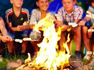 11 Campfire Games for Kids of All Ages | If you're looking for activities for families to enjoy around the campfire, we've got 11 ideas you'll love! Perfect for toddlers, for kids, for tweens, for teens, for a small group, and for a crowd, these ideas are easy to set-up and so much fun. Whether you're going on a family road trip, camping with a youth group, Girl Scout or Boy Scout troop, or organizing an outdoor campout in your backyard, these ideas work as great drinking games for adults too!
