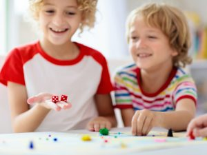 10 Easy Dice Games for Kids   If you're looking for portable travel games and/or need ideas for family game night, these dice games are family friendly and much fun. With options for 2 players as well as games you can play with a large group, we've included a mix of simple DIY dice games and classic store bought games you'll love. These make great camping activities, and are also perfect for road trips and those who need airplane activities for kids. Roll the dice and see what you think!