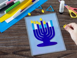 24 Hanukkah Crafts For Kids   Whether you're looking for Hanukkah themed art projects for the classroom, or crafts and activities you can enjoy at home with your kids to mark the holiday, this post has tons of ideas to inspire you. Learn how to make a dreidel out of clay, paper plate menorahs, a sparkling Star of David, Hanukkah slime, Hanukkah pipe cleaner candles, and more! Oh, and don't miss the marshmallow dreidel recipe - it's delicious!