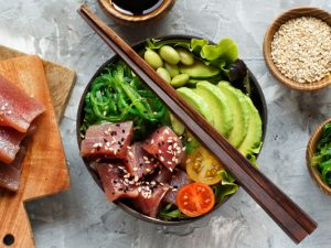 35 Easy Homemade Poke Bowl Recipes | If you love poke bowls but feel too intimidated to make them yourself, this post is for you! We're sharing everything you need to know to make the perfect DIY poke bowl, from rice alternatives, to sauce inspiration, to healthy toppings and more. From ahi tuna, salmon, shrimp, and chicken recipes, to vegetarian and vegan poke bowls that use tofu, we're sharing the best ingredients to create your own Hawaiian meal at home!